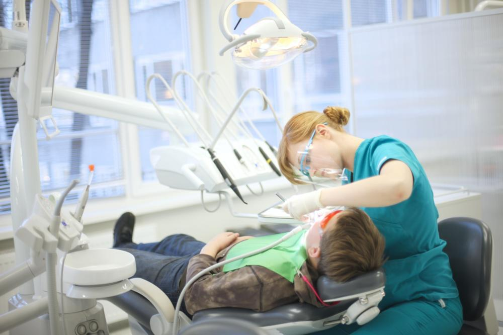 patient in dental chair with hygienist | dentist in lansing il