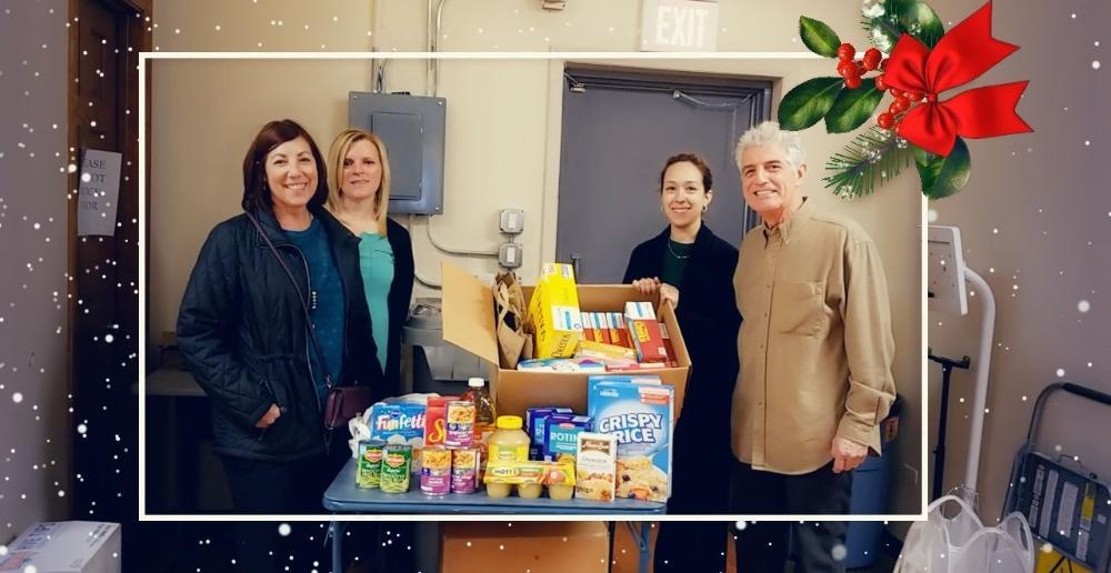 The team at Pallotto Dental Care, participating in a food drive for the Lansing, IL community