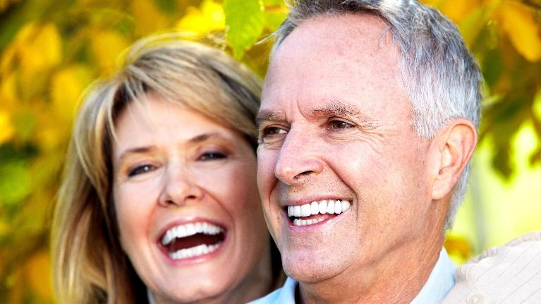 Smiling Couple | Dental Implants Lansing IL