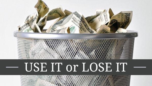 use it or lose it title with money in a trash can